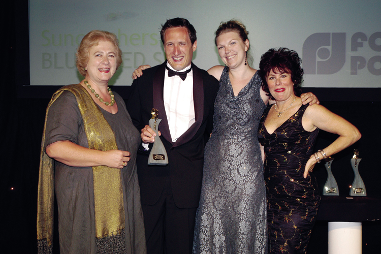 Jo Corner and Jeremy Corner accepting the Best Cards for Design-Led Shops Prize at the Gift of the Year Awards